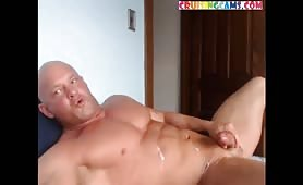 Cumshot from a cute muscular mature bodybuilder
