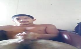 Cute latin dude stroking in front of a web cam