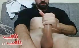 Handsome turkish guy wanks his huge cock