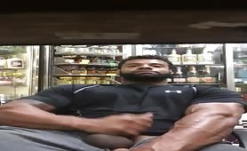 Big strong bodybuilder stroking his cock in a liquor store