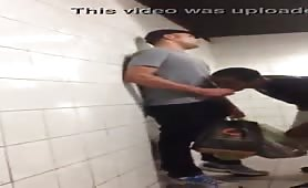 Black gay sucking and swallowing cum in a public toilet