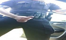 A very horny policeman masturbating in the street