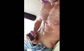 Handsome hairy stud strokes his huge cock solo