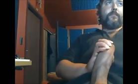 macho latin guy stroking his big fat cock