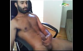 Bearded arab guy wanking in front of a webcam